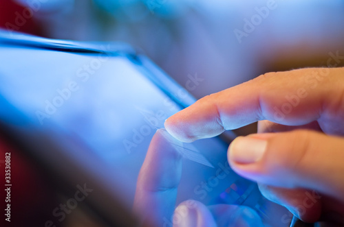 closeup of finger touching screen  on tablet-pc - 33530882