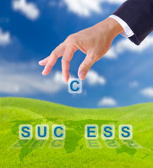 hand puting letter c to  success word