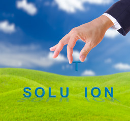 business man hand and solution word