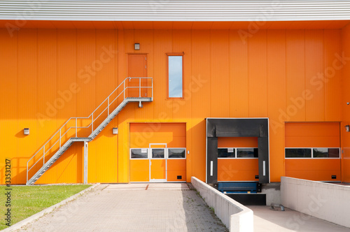 orange building with loading dock and fire escape stair