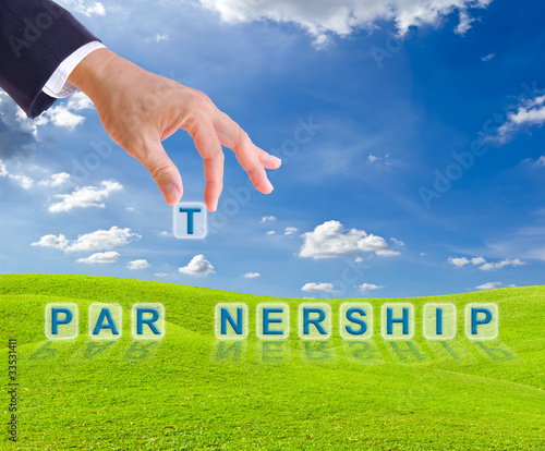business man hand and partnership word