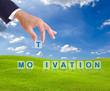 business man hand made motivation word buttons