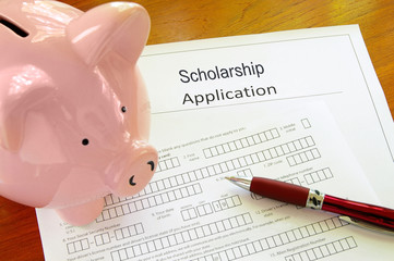 Blank scholarship application form with piggy bank