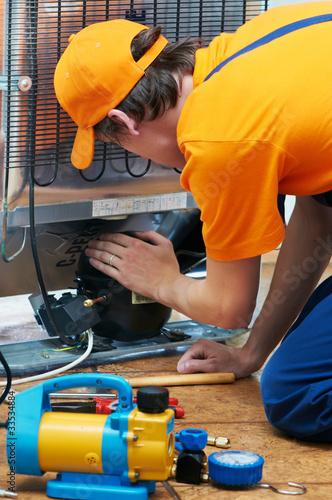 Leinwanddruck Bild repair work on fridge appliance