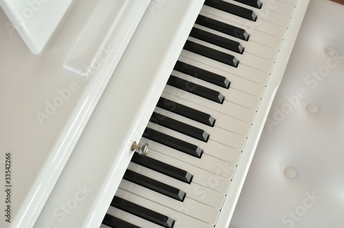 white piano and chair