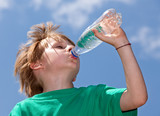 Thirsty boy drinking fresh water outdoors poster