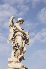 Statue of an Angel on Pont Sant' Angelo  in Rome, Italy.