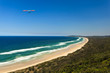 Hang Glider Flying Over Beach in Byron Bay AU