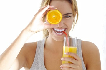 young woman with orange juice