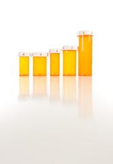 Empty Medicine Bottles on Reflective Surface