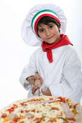 A young pizza maker