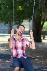 Young Man Having Fun on Swing