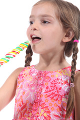 Little girl with multicolored lollipop