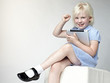 Happy little girl  has fun with touchpad