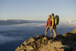 Hikers enjoy the view at the summit