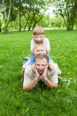 Portrait of father with two sons outdoor