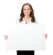 Smiling businesswoman showing blank signboard, isolated