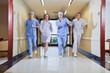 Team of surgeon and nurse running
