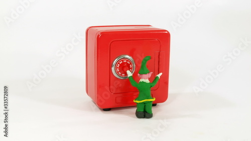 Claymation Elf helps Santa open a safe full of gifts.