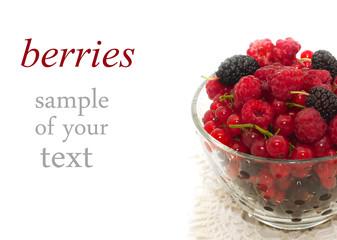 assorti of fresh berries in glass bowl
