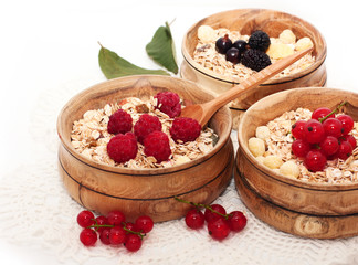 wooden bowls with cereals and berries