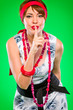 Sensual girl with finger near mouth showing silence gesture.