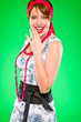 Smiling woman holding hand near mouth. Pin up and retro style