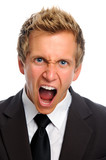 man in suite with rage poster