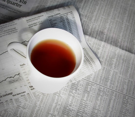 financial news and tea cup