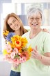 Happy senior mother with flowers at mother's day