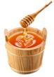 Piggin of honey and wooden stick.