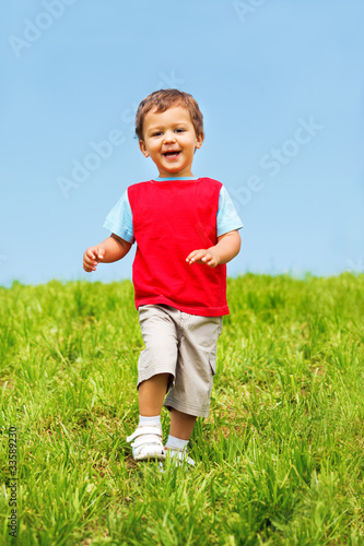Laughing boy running
