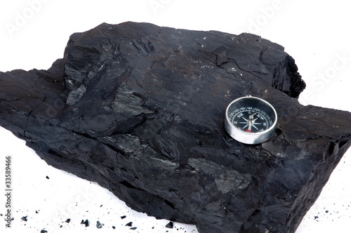 a lump of coal and compass