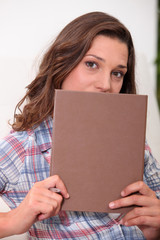 Young woman holding diary
