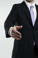 businessman extending hand for a handshake