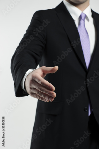 businessman extending hand for a handshake
