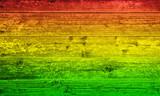 Fototapety Holzbrett Hintergrund in Reggae-Farben