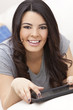 Happy Hispanic Woman Using Tablet Computer