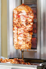 Kebab, meat roasted on large, rotating vertical spit