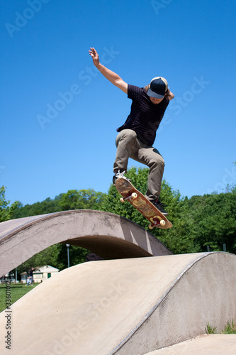 Skateboarder Doing a Jump at a Concrete Skate Park