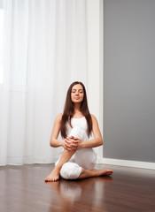 woman doing yoga exercise on floor