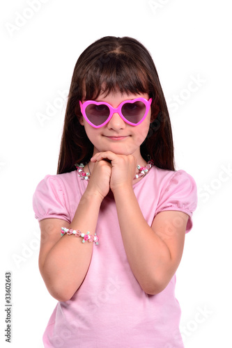 Young coquette girl wearing pink dress and glasses