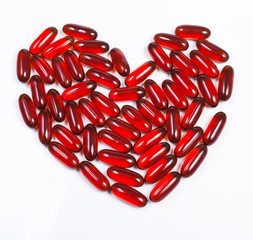 Heart made of red capsule