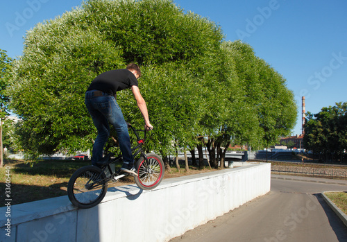 boy jumping from wall on bmx