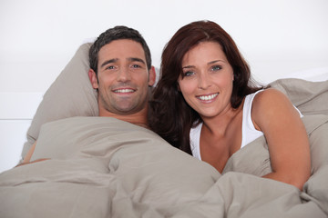 A man and woman lying in bed