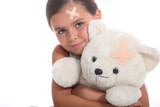 Girl and teddy with a plaster