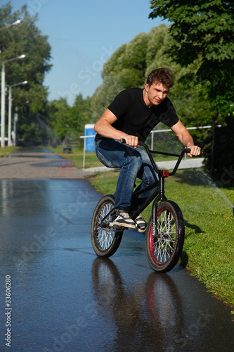 boy riding   on street  bmx