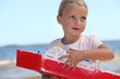 Girl holding toy ship