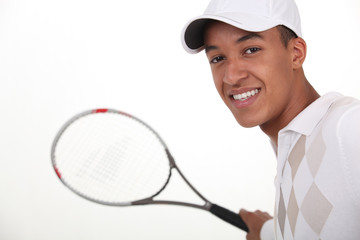 Young man dressed for tennis
