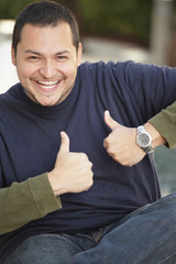 Man showing two thumbsup